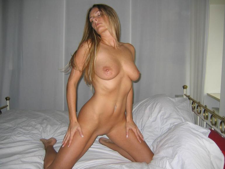 Sexy long-haired wife is posing on the bed - 10