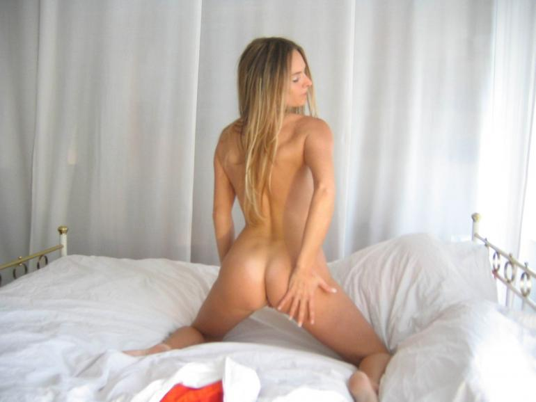 Sexy long-haired wife is posing on the bed - 11