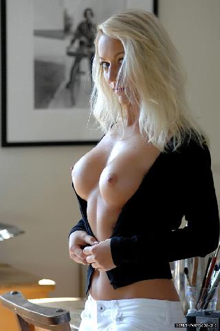 Blonde Ivana is showing her amazing boobs