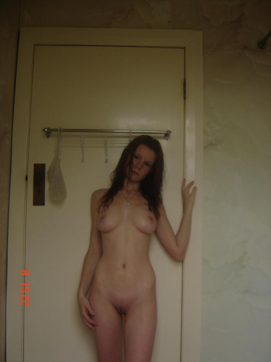 Young redhead is showing her pale body - 10