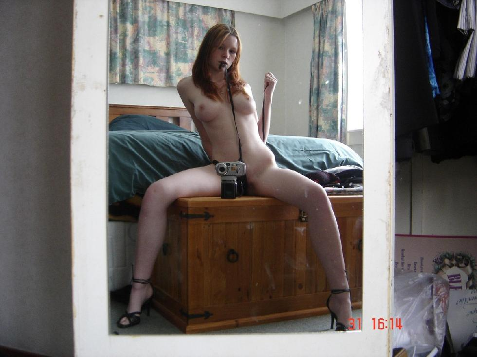 Young redhead is showing her pale body - 3