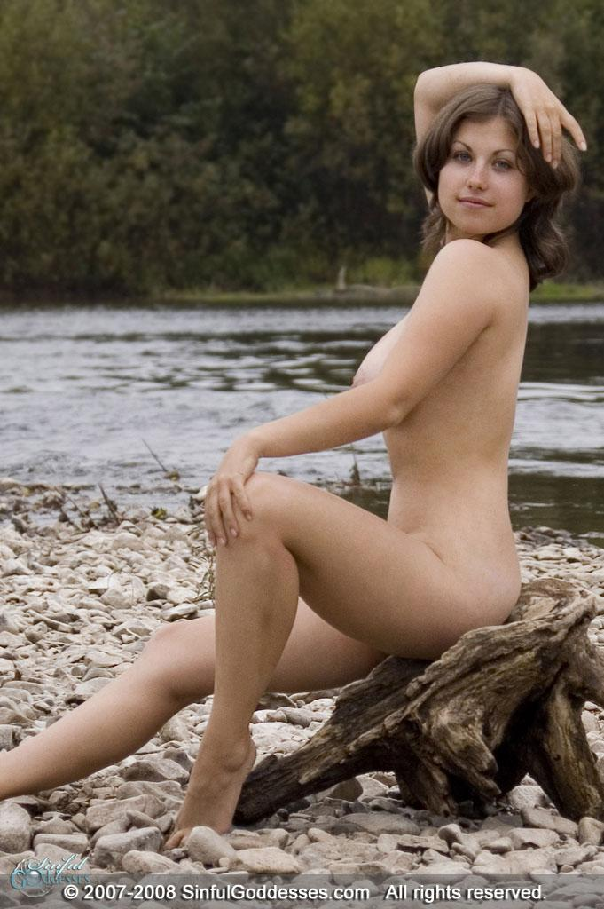 Mia is posing naked on the beach - 1