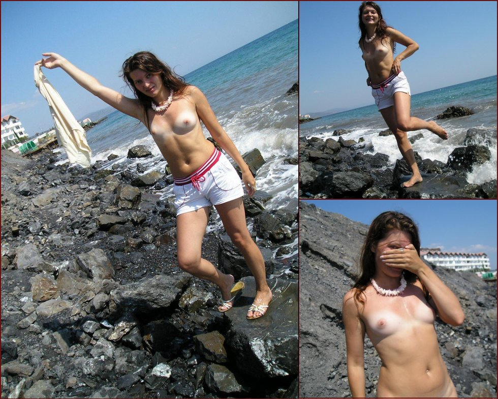 Larisa is posing naked on a rocky beach - 13