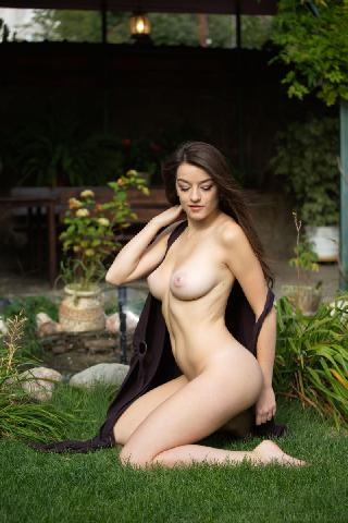 Charming Vanda Mey is posing in the garden