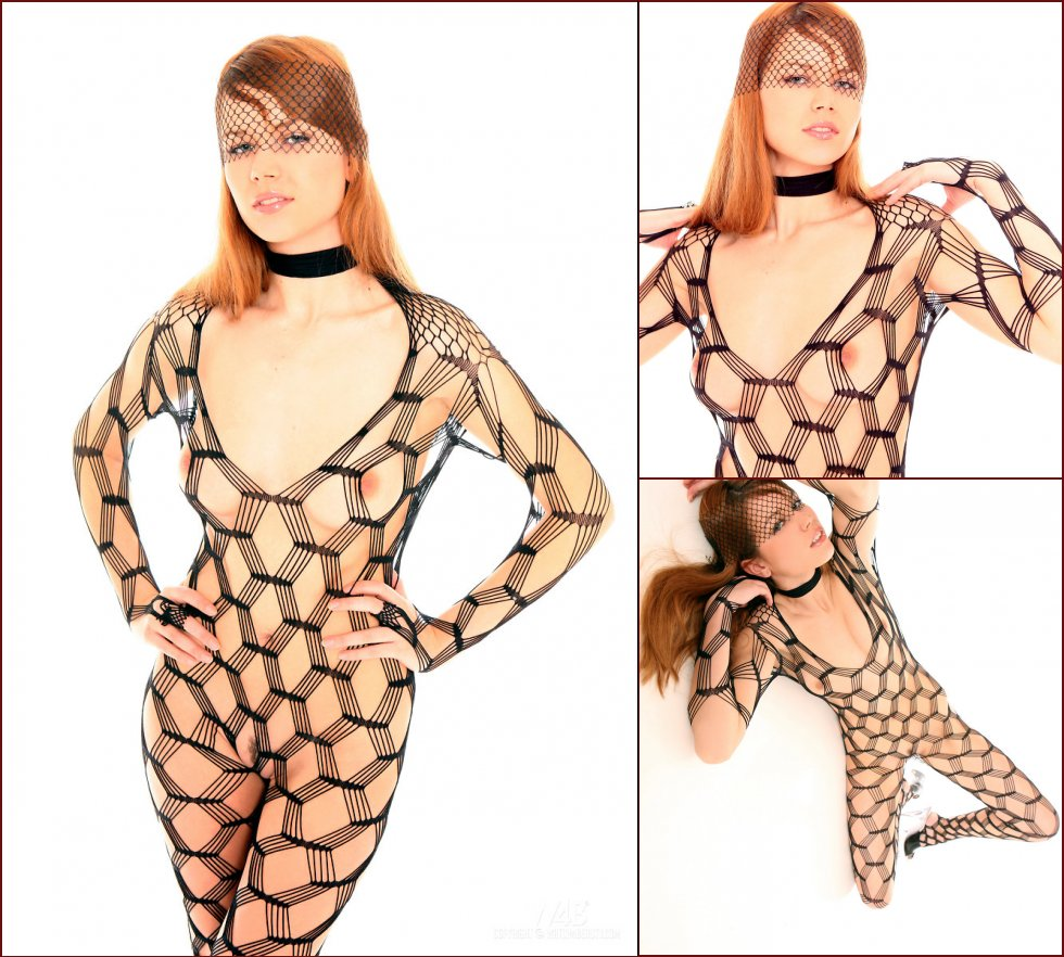 Young redhead in hot fishnet bodystocking - Camelie - 33