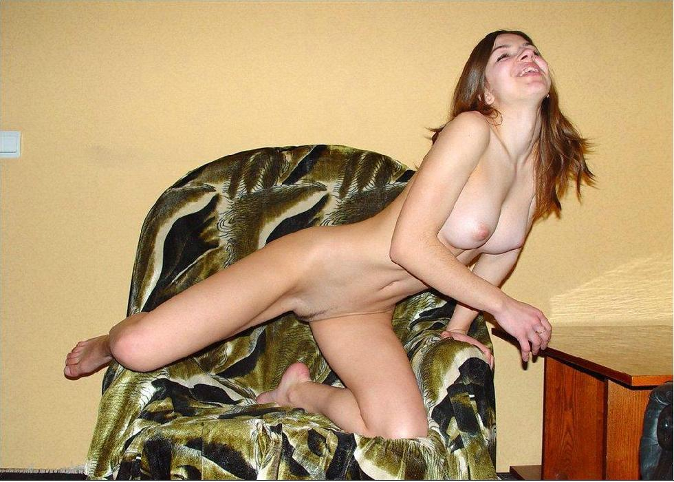 Naked young girl is spreading legs - 1