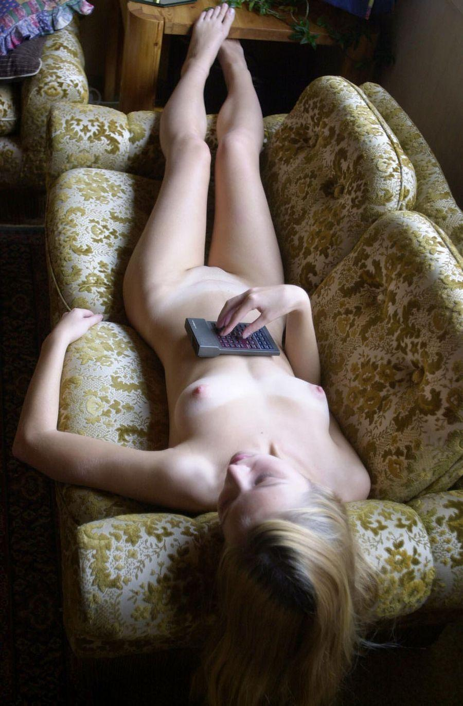 Naked young girl is lying on the couch - 8