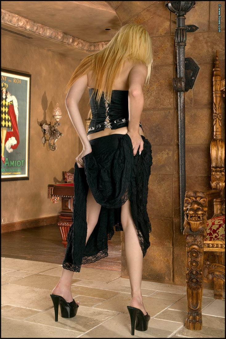Leggy busty blonde in black - Ami Starr - 5