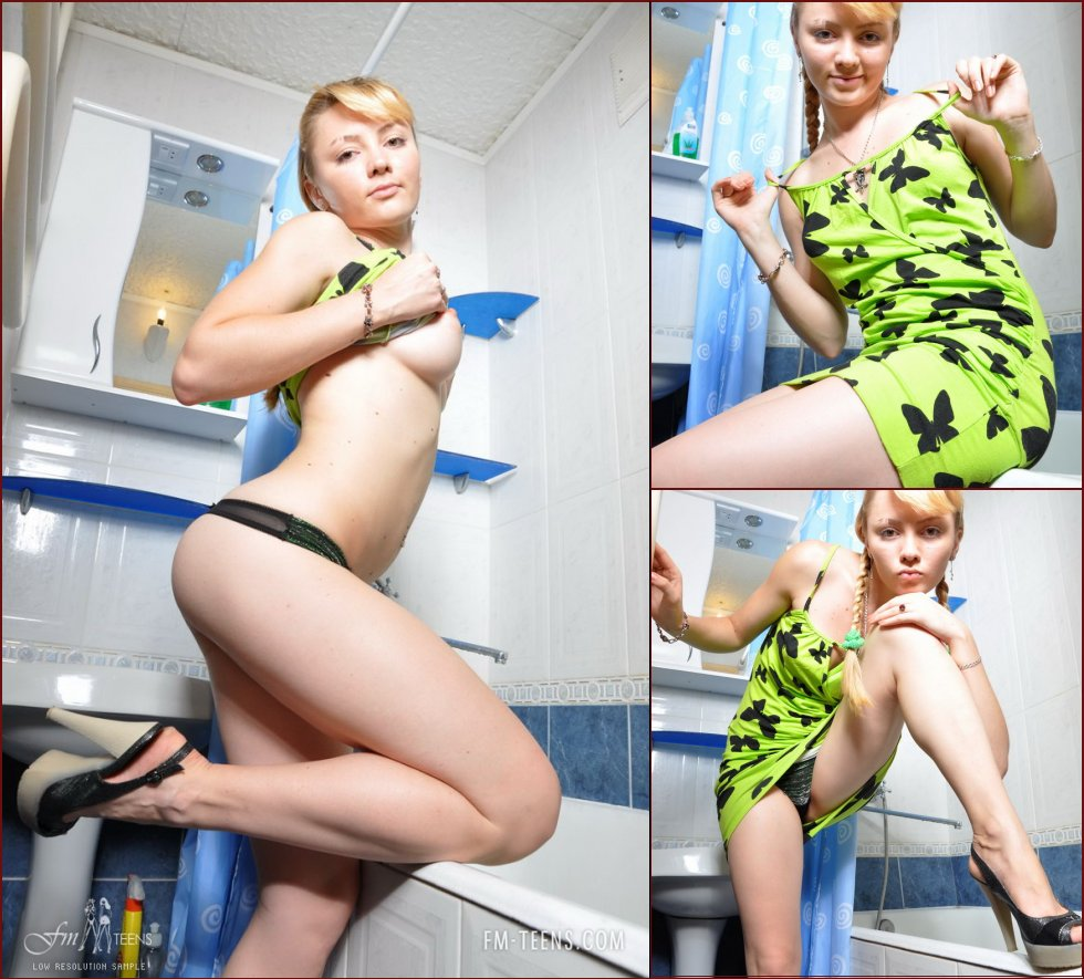 Cute young blonde is taking a bath - 1