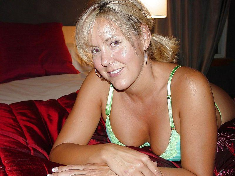 Busty, horny MILF on the bed - 2
