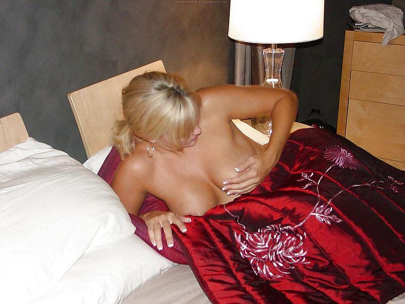 Busty, horny MILF on the bed - 4