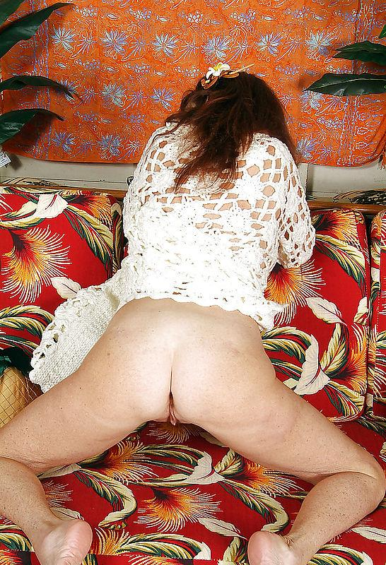 Busty mature on a sofa - 3