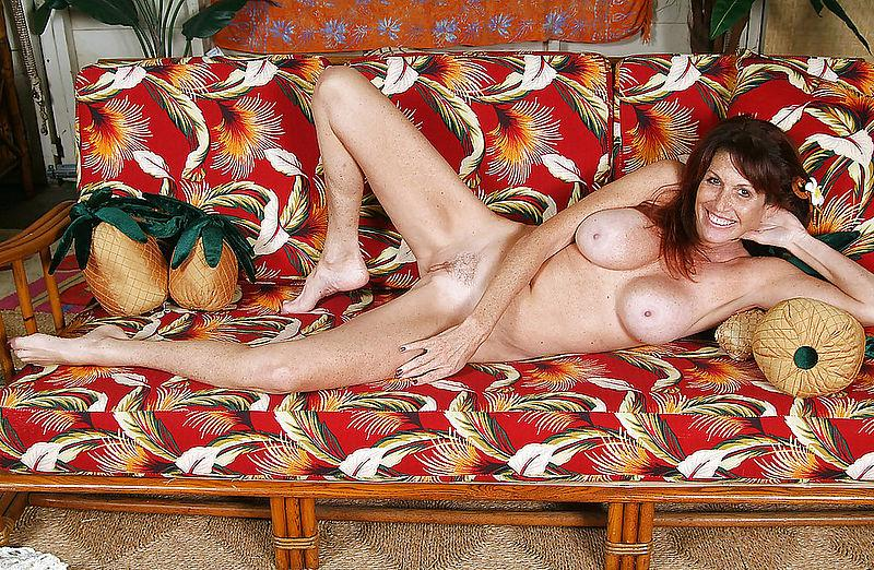 Busty mature on a sofa - 6