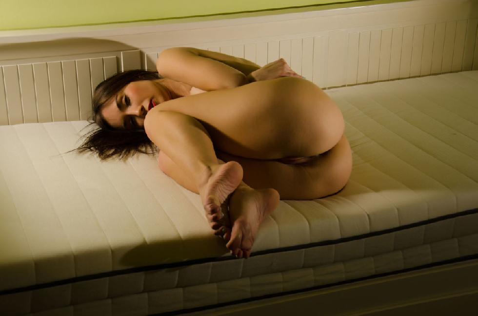 Sensual Dorova shows tight pussy on a sofa - 11