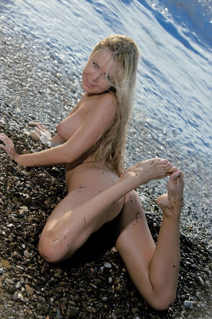 Seductress Chloe on the stony beach - 11