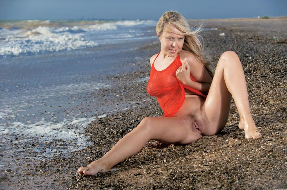 Seductress Chloe on the stony beach - 3