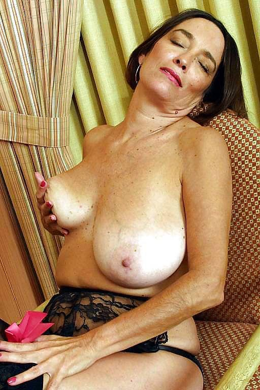 Busty mature on a chair - 4