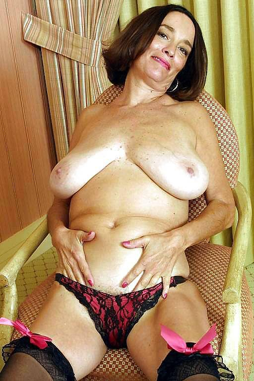 Busty mature on a chair - 5