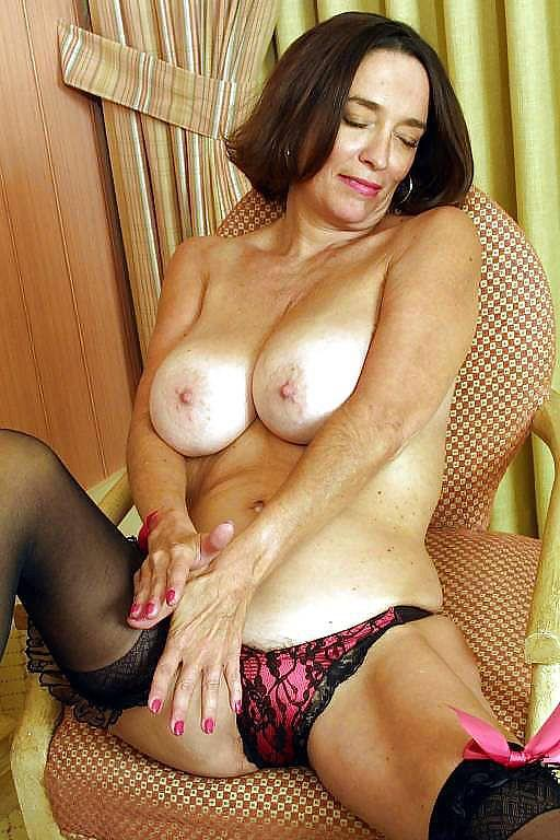 Busty mature on a chair - 7