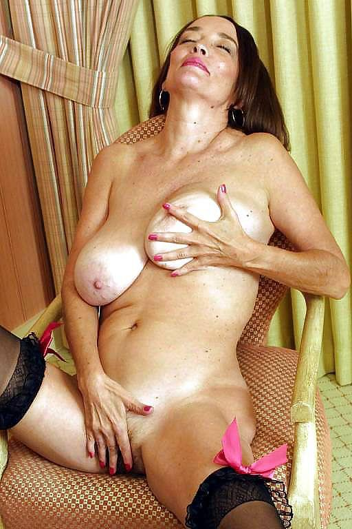 Busty mature on a chair - 8
