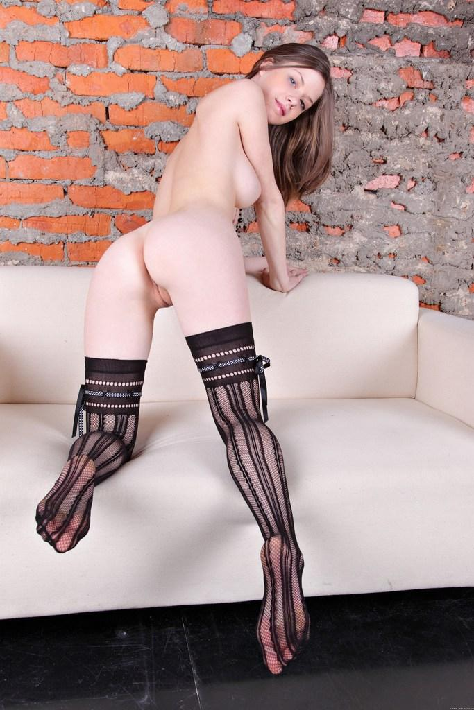 Shy girl in sexy stockings on the sofa - Anita - 8