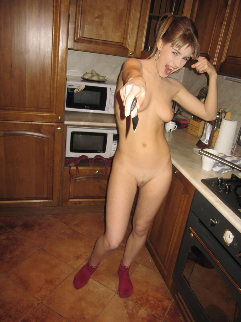 Horny blonde in the kitchen - 13
