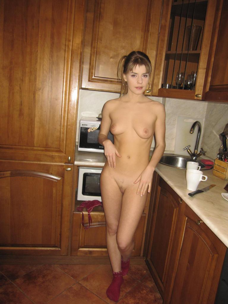 Horny blonde in the kitchen - 18