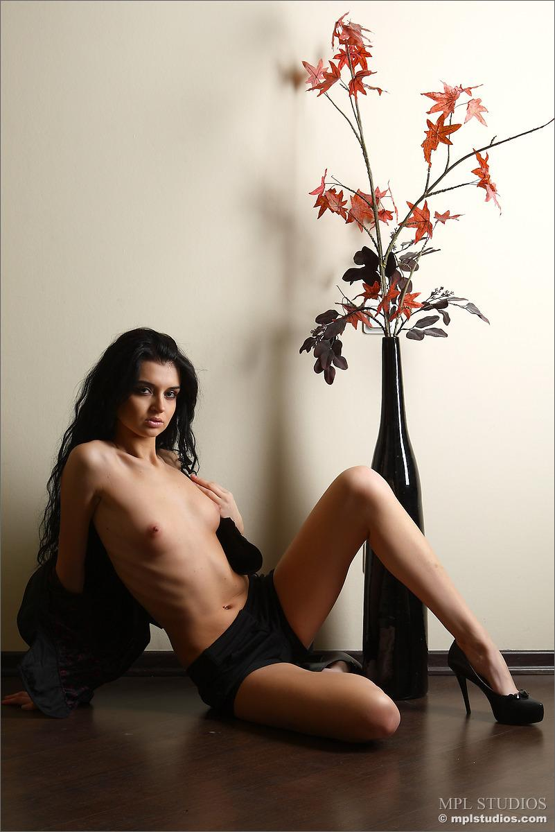 Dark-haired Renata is posing with a flower vase - 3