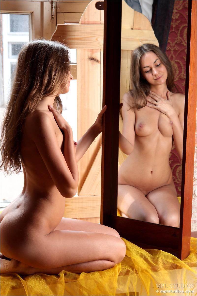 Mika is enjoying looking at herself in a mirror - 5
