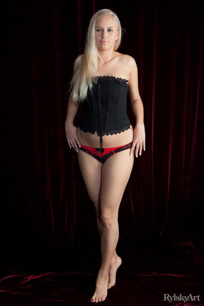Paige is stripping her red panties and black corset - 1