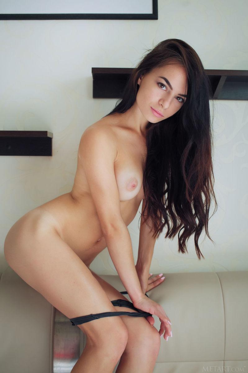 Leggy Debora is posing on a big bed - 2