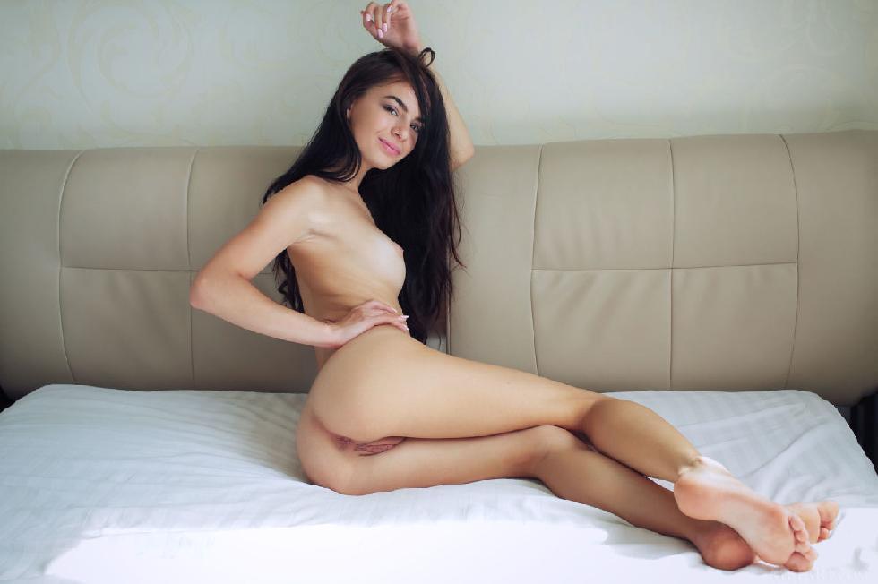 Leggy Debora is posing on a big bed - 4