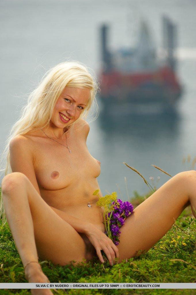 Silvia is doing striptease on the green field - 15