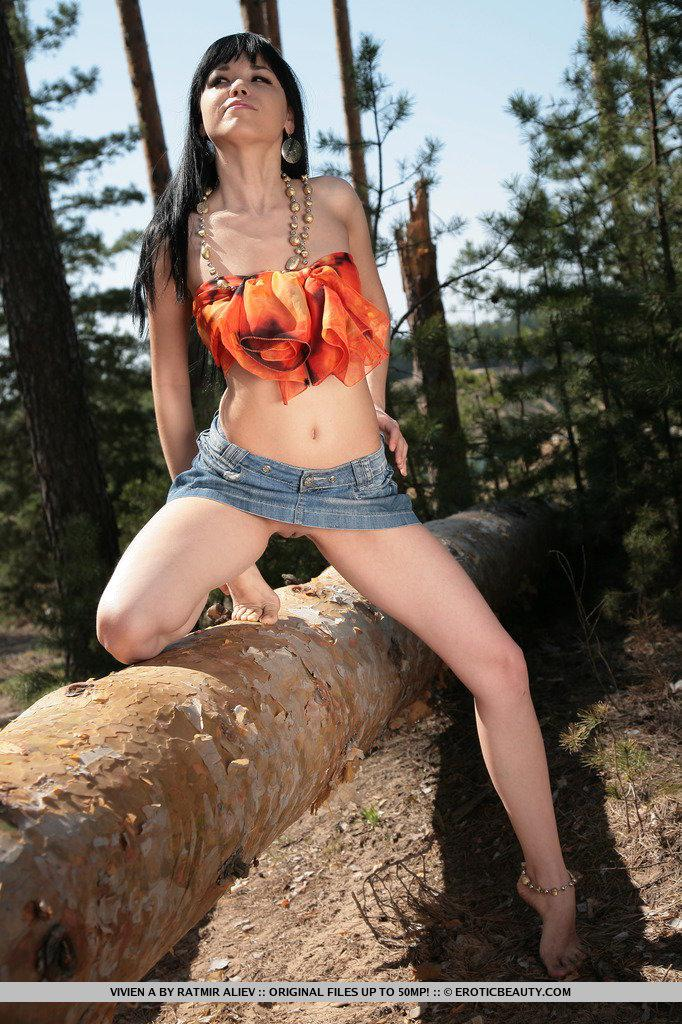 Adorable Vivien is posing in the forest