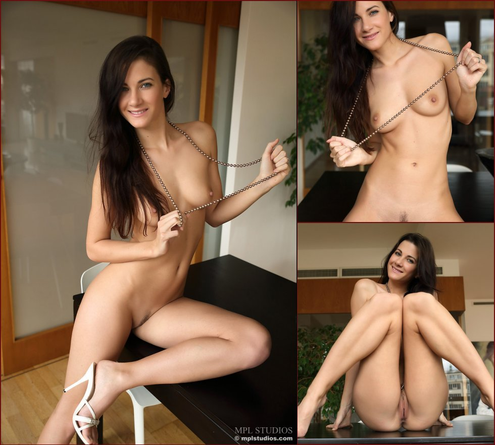 Long-haired Lauren likes to sit naked on the table - 71