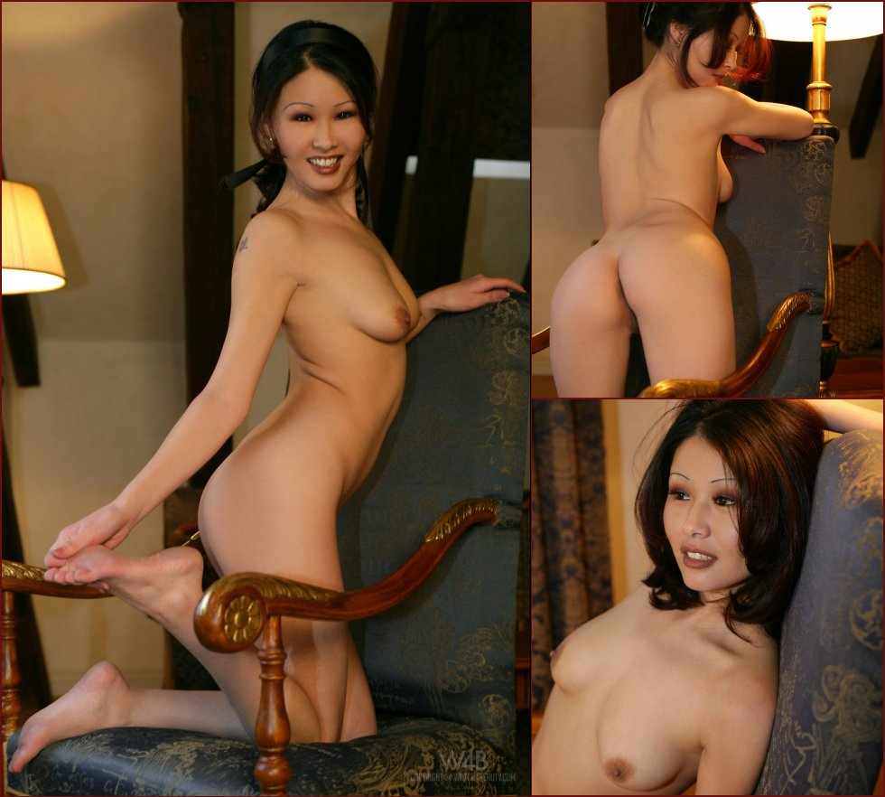Naked Asian is posing on a chair - Anya - 34