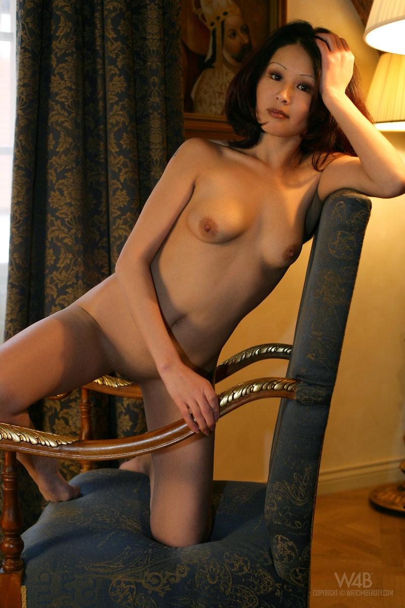 Naked Asian is posing on a chair - Anya - 10