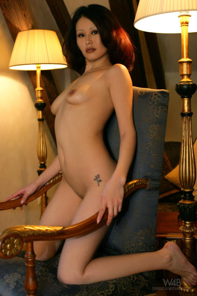 Naked Asian is posing on a chair - Anya - 11