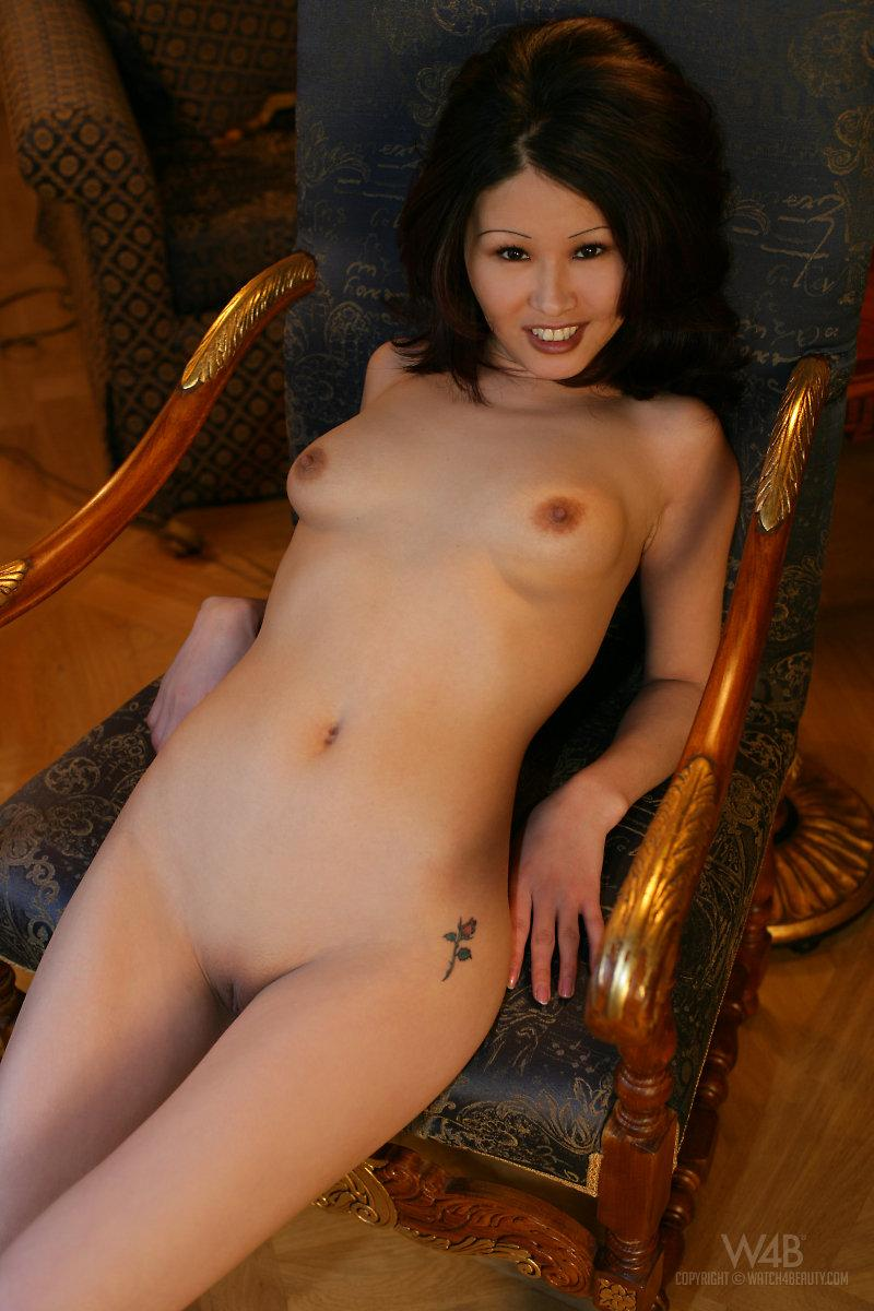 Naked Asian is posing on a chair - Anya - 4