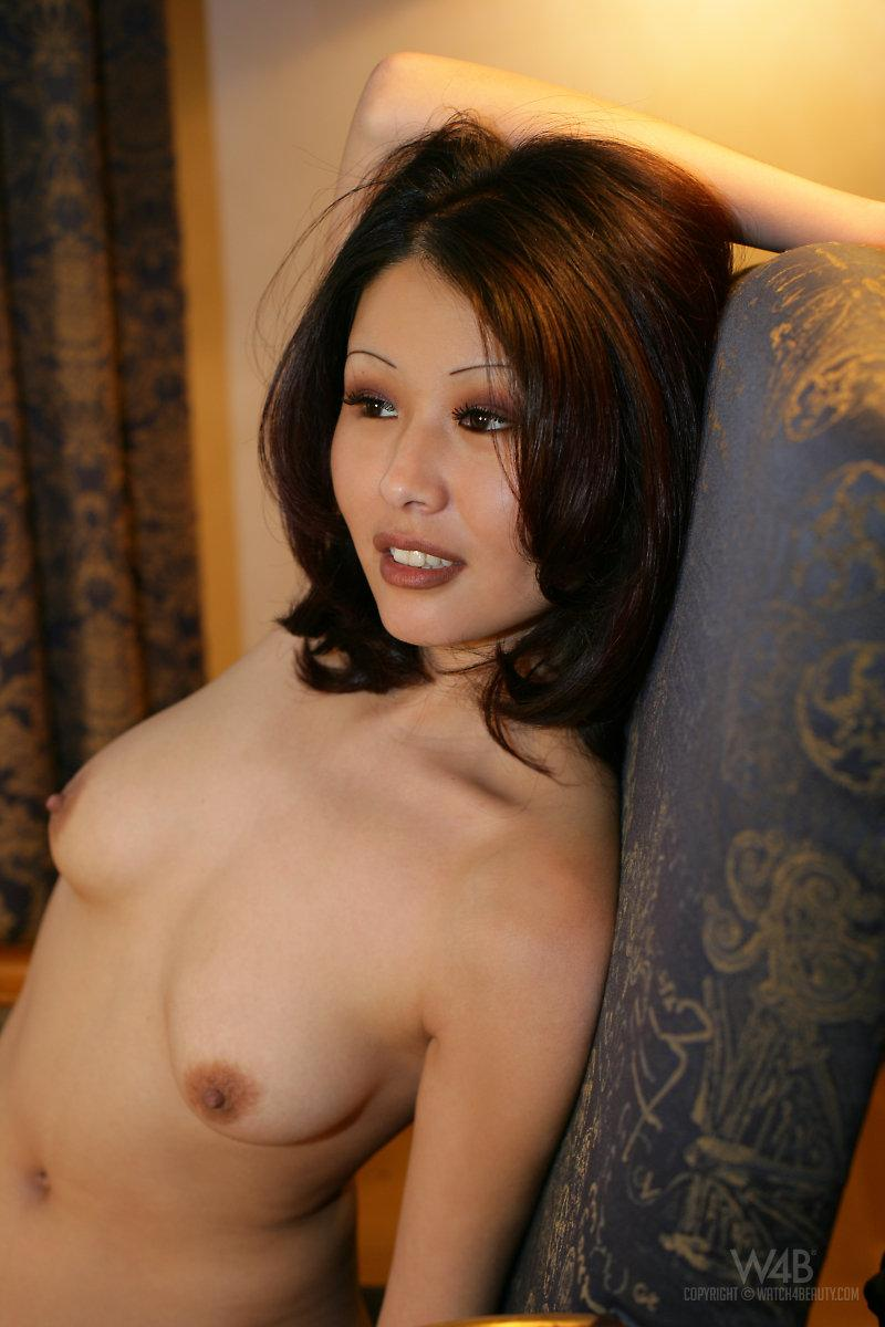 Naked Asian is posing on a chair - Anya - 6