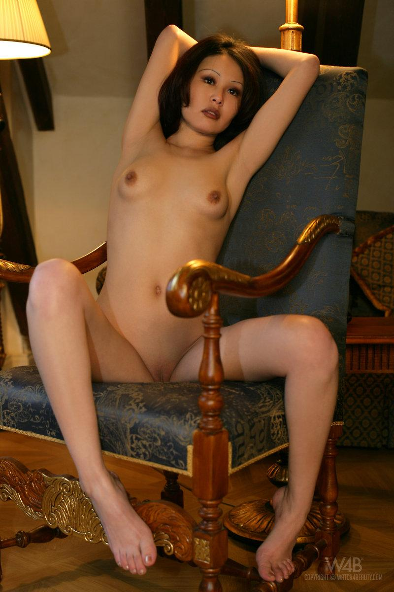 Naked Asian is posing on a chair - Anya - 7