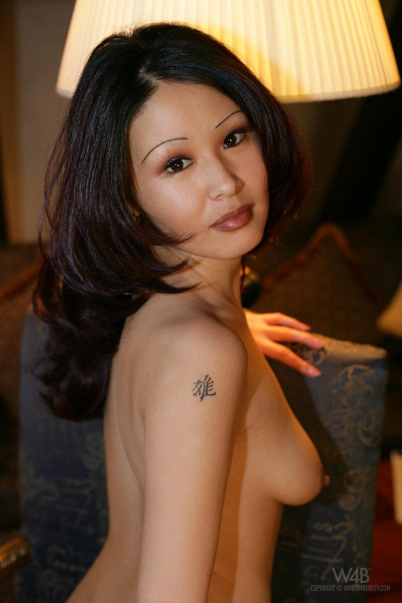 Naked Asian is posing on a chair - Anya - 8