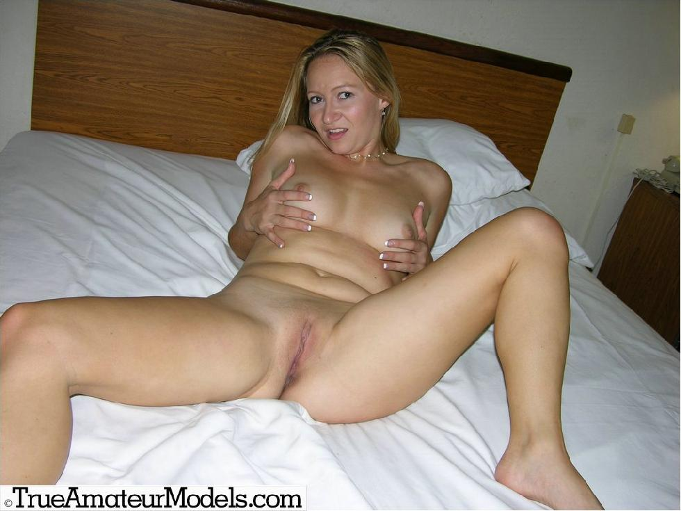 Karinne is posing naked on a big bed - 13