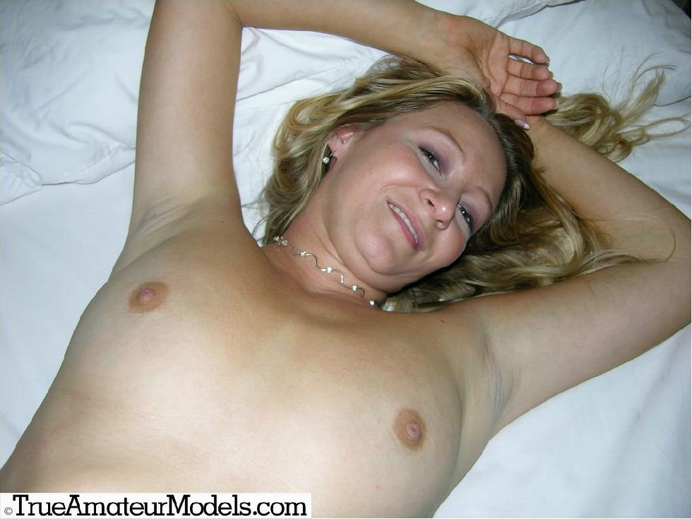 Karinne is posing naked on a big bed - 9