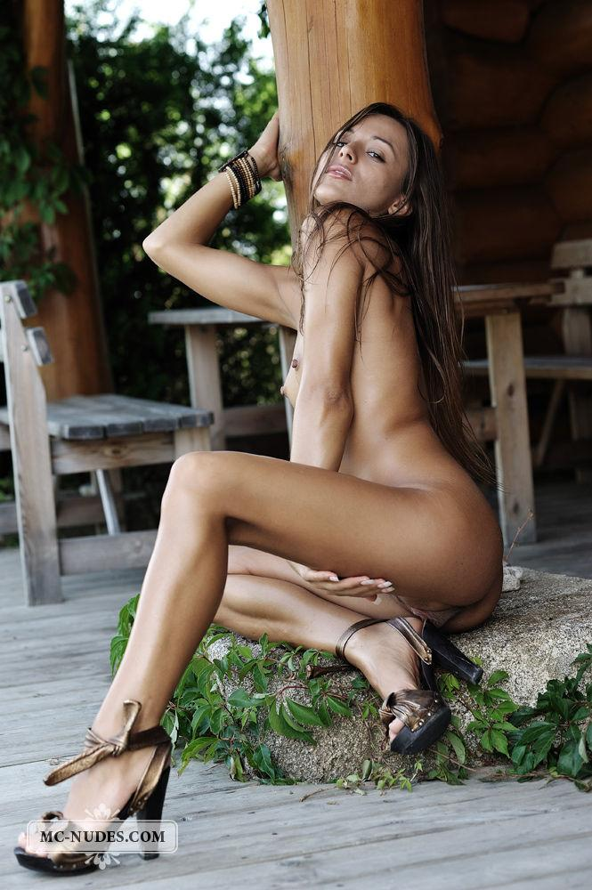 Naked Dominika is spreading her long legs - 10