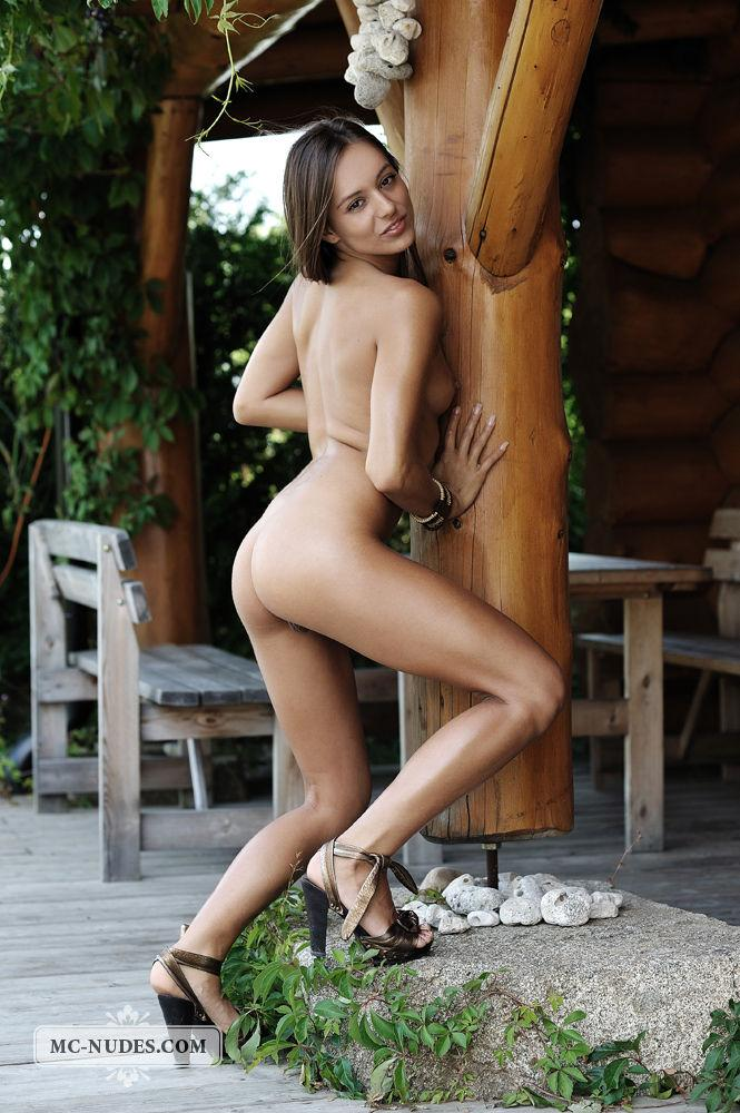 Naked Dominika is spreading her long legs - 5