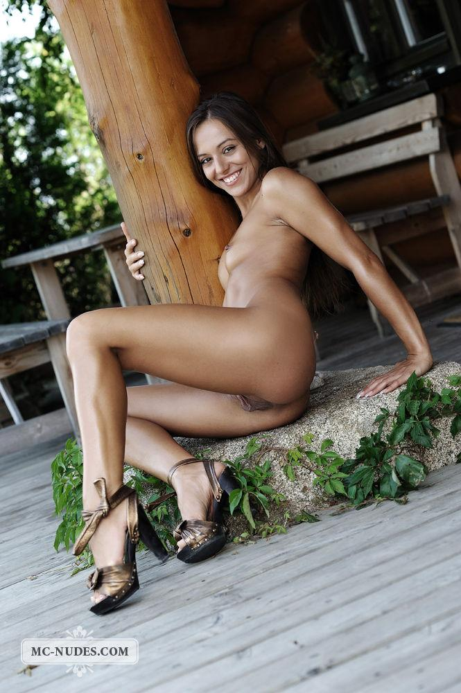 Naked Dominika is spreading her long legs - 9