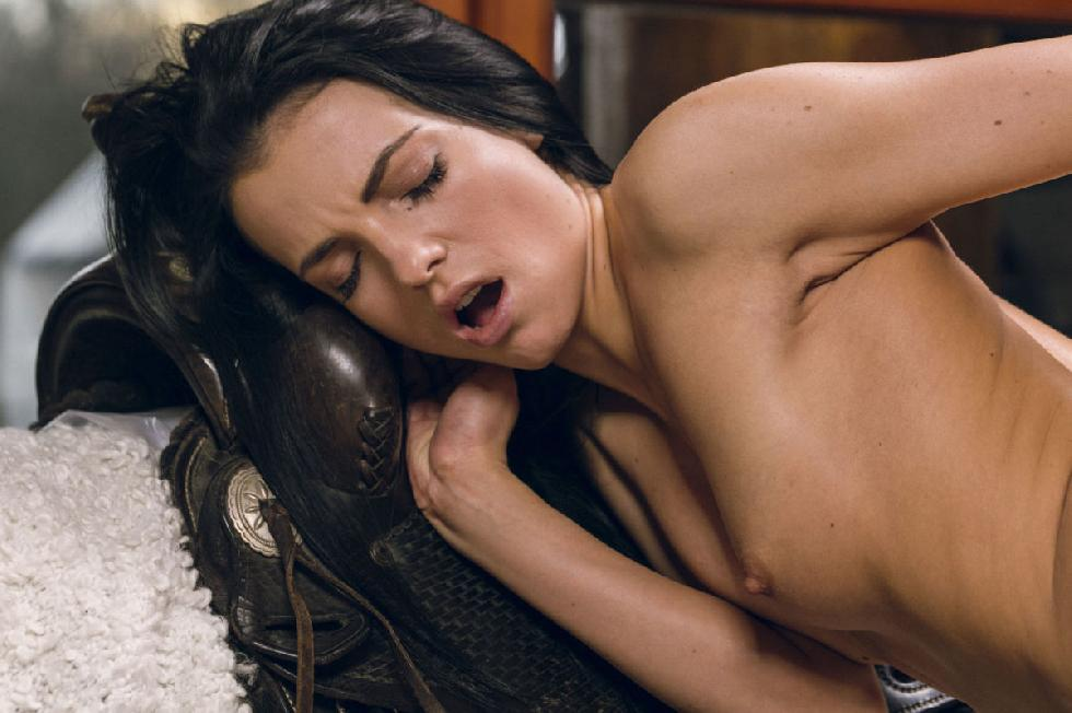 Brunette Sapphira is pleasuring herself on the couch - 12