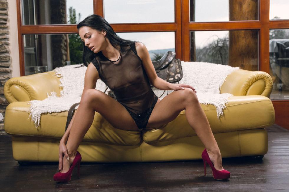 Brunette Sapphira is pleasuring herself on the couch - 3