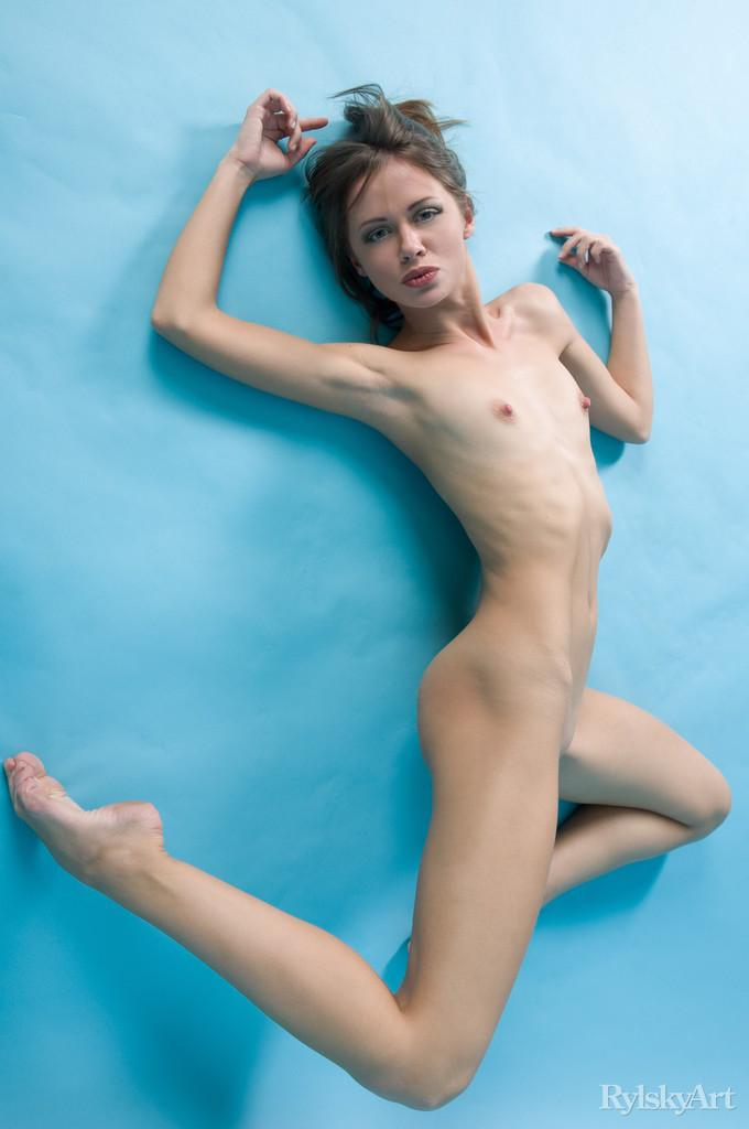 Naked Kalla is posing at a blue studio - 12